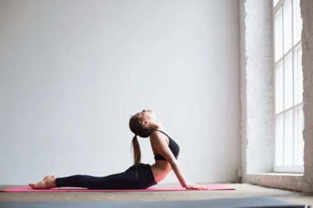 Young woman practicing yoga. STDcheck.com