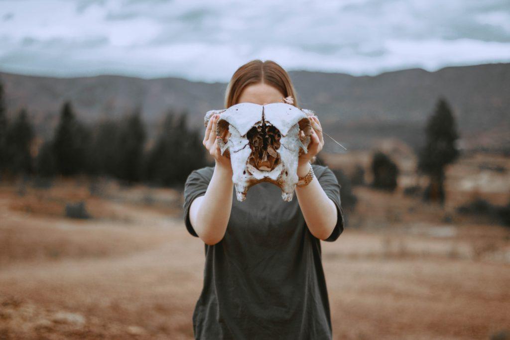 girl holding skull