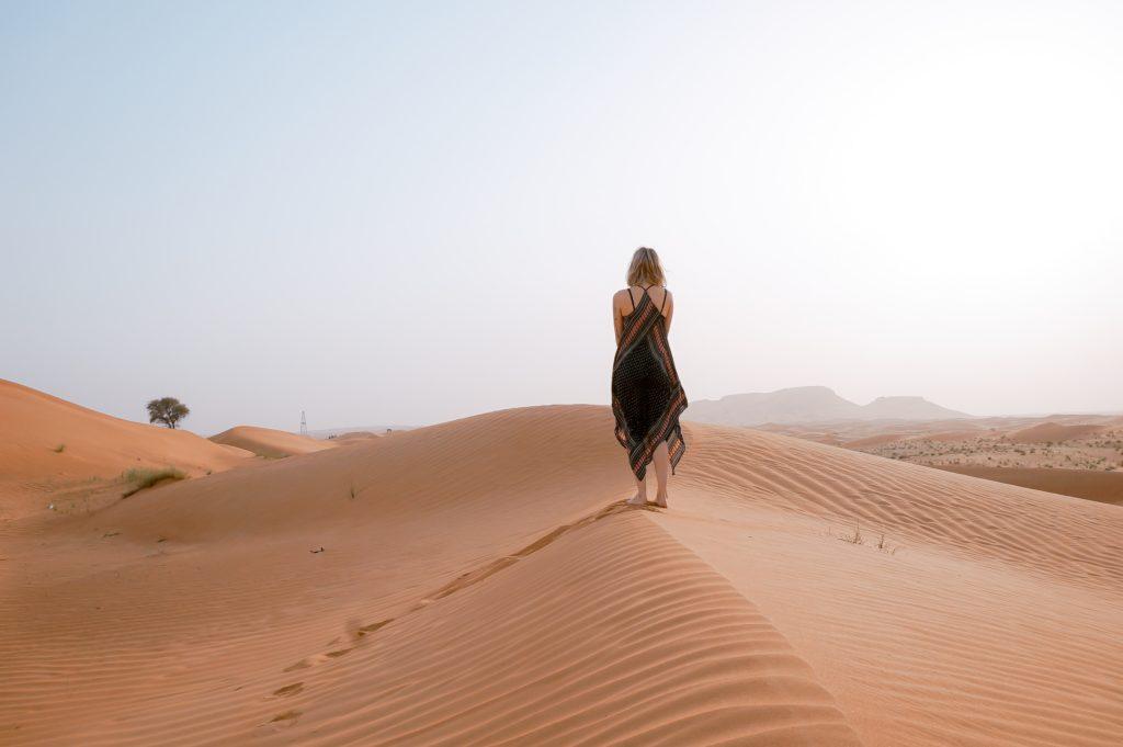 girl walking in the desert dry