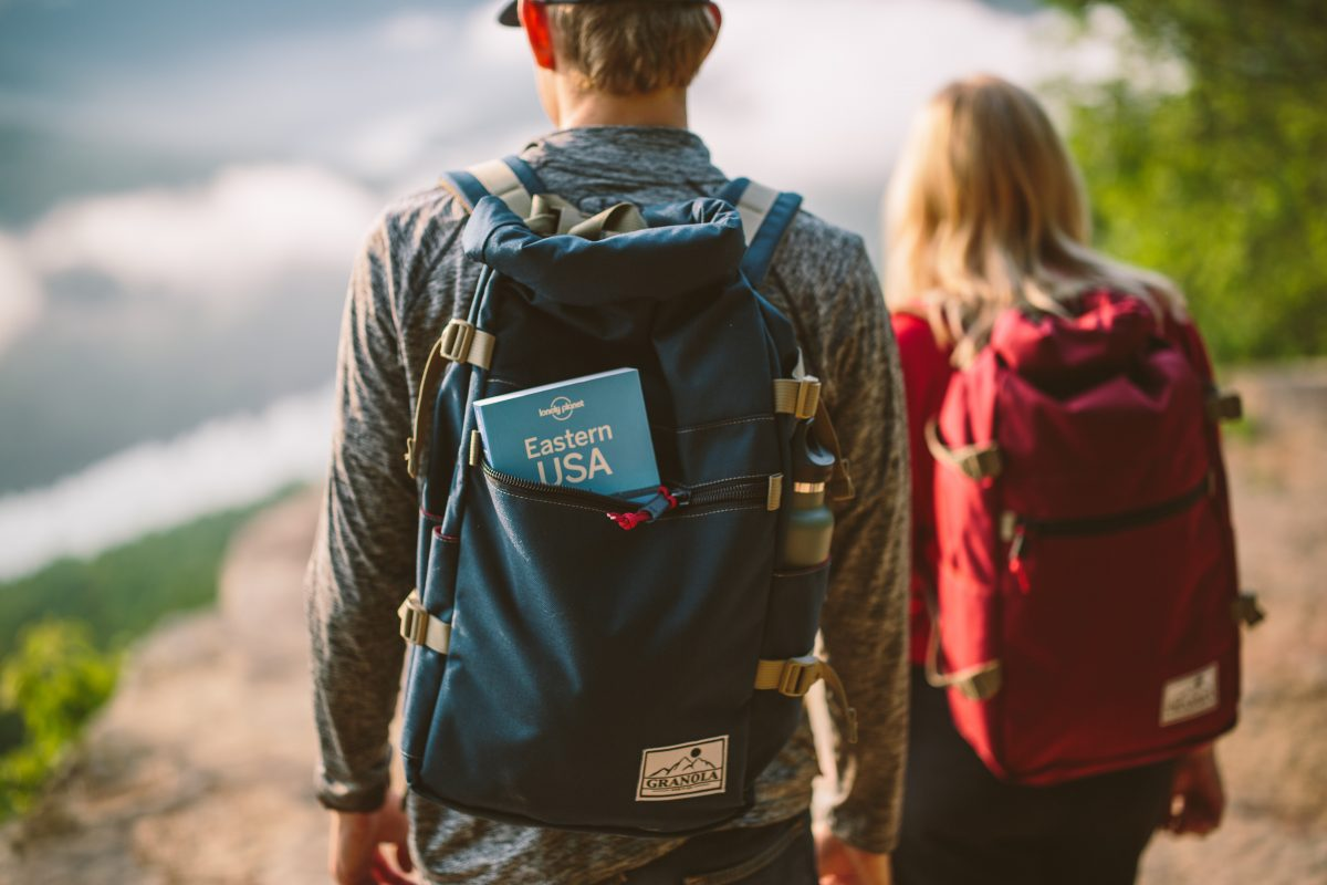 man and woman backpacking